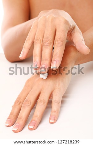 Closeup image of hands in SPA iolated over white background