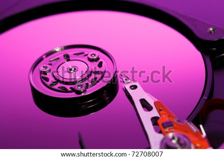 Closeup image of hdd drive. Focused on playback head - stock photo