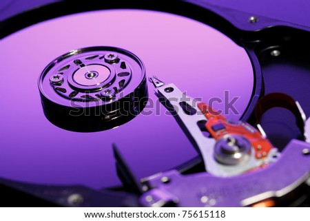 Closeup image of hdd drive. Focused on reading head. - stock photo