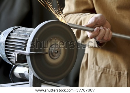 closeup image of manual worker and classic grinder