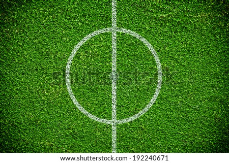 Closeup image of natural green grass soccer field - stock photo