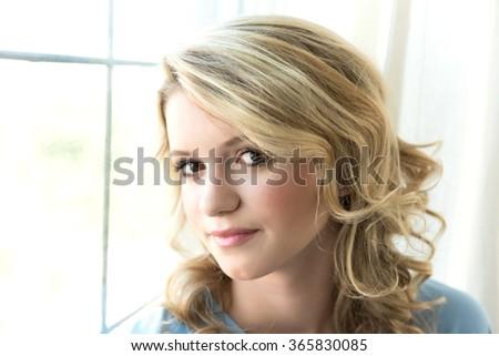 Closeup image of pretty girl looking at the camera - stock photo