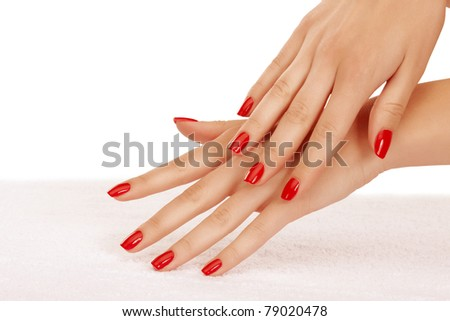 Closeup image of red manicure on top of towel - stock photo