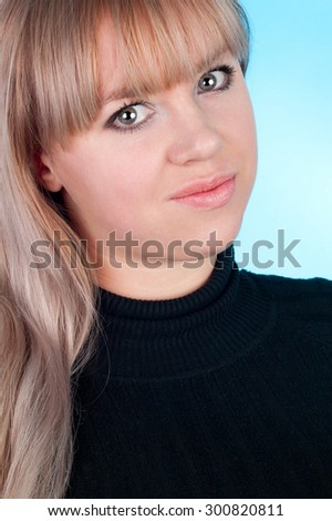 closeup image of the beautiful blond girl on the blue background