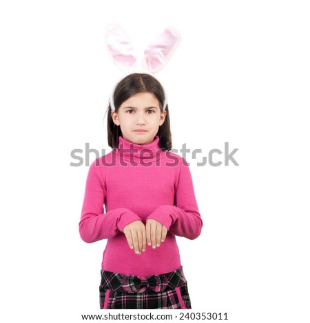 closeup image of the beautiful cute little girl in the hare ears - stock photo