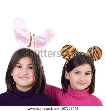closeup image of the beautiful little twin sisters in the hare and tiger carnival ears - stock photo
