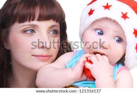 closeup image of the beautiful young woman with her cute sweet baby in the Christmas cap