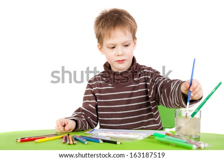 closeup image of the cute little boy painting