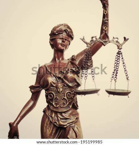 closeup image of Themis goddess or lady justice holding scale blindfold on light background - stock photo