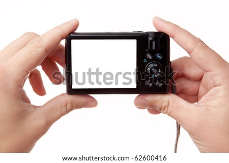 Closeup image of two hands holding black compact digital photo camera with empty display for your picture or text (copy space), isolated on white background - stock photo