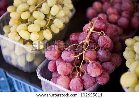 Closeup image of unwashed red and green grapes. - stock photo
