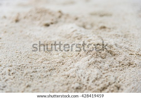 Closeup image of white sand with selective focus