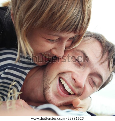 Closeup image of young happy smiling couple - stock photo