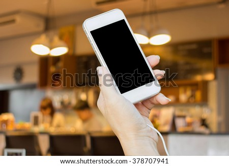 Closeup image on a female hands holding smartphone - stock photo