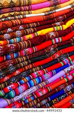 closeup image on classic colorful peruvian fabric background - stock photo