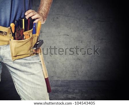 closeup image on handyman tool belt - stock photo