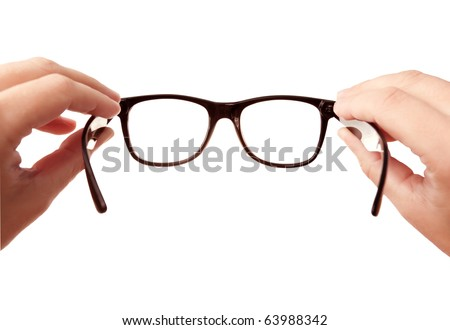 Closeup image: two hands holding black classic glasses while putting your eye-wear on, isolated on white background, may use as copy space for your text or object - stock photo