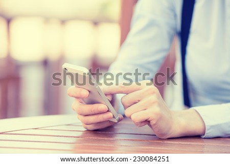 Closeup image woman hands holding, using smart, mobile phone isolated outside city background. New generation technology, people phone addiction concept. Customer, service provider relationship - stock photo