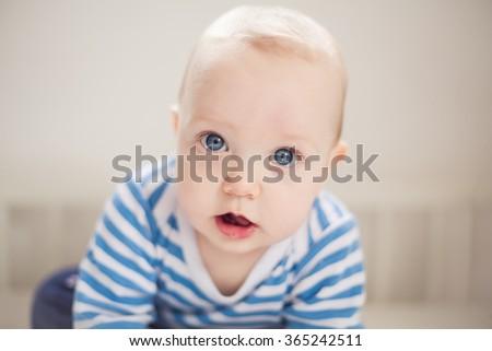 Closeup indoor portrait of a cute little baby boy - stock photo