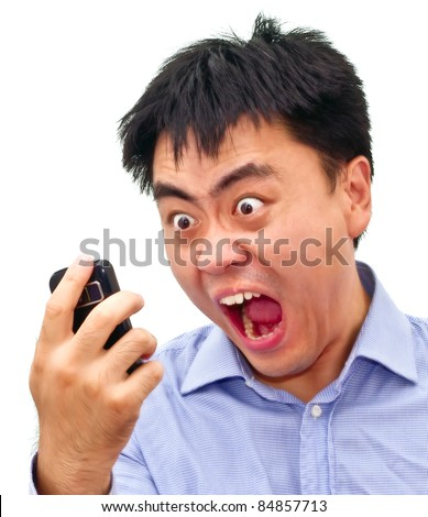 Closeup isolation photo of a crazy angry asian man yelling at his cellphone - stock photo