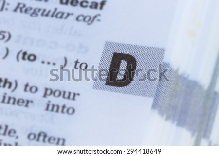 closeup letter D in dictionary, soft focus, - stock photo