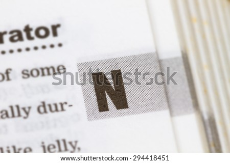 closeup letter N in dictionary, soft focus, - stock photo