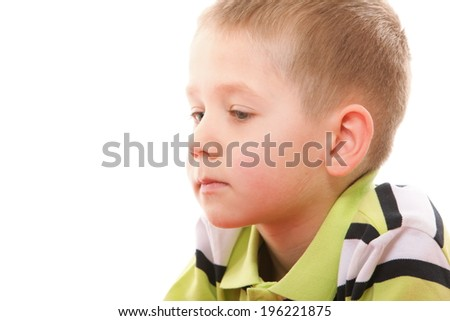 Closeup little caucasian pensive boy portrait isolated on white background - stock photo