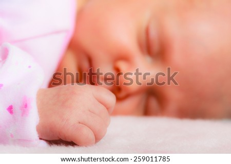 Closeup little newborn baby girl 24 days sleeping