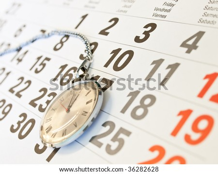 Closeup �lock and  calendar