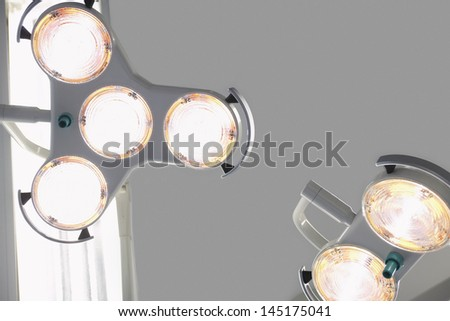 Closeup low angle view of operating room lighting - stock photo