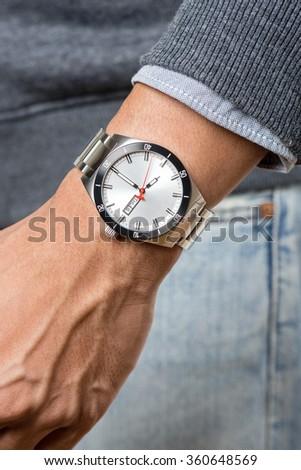 closeup luxury watch on man's wrist - stock photo