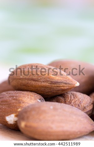 Closeup macro bunch of almonds with blurred background - stock photo