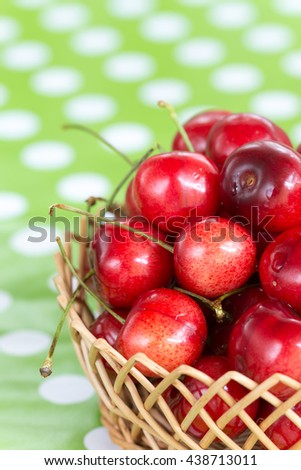 Closeup macro cherries in the basket blurred background