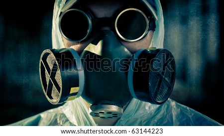 closeup man face in respirator and glasses - stock photo