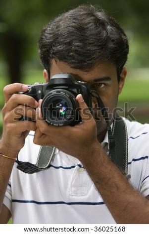 Closeup Man Holding Camera - stock photo