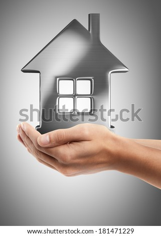 Closeup. Man's hand holding house  High resolution  - stock photo