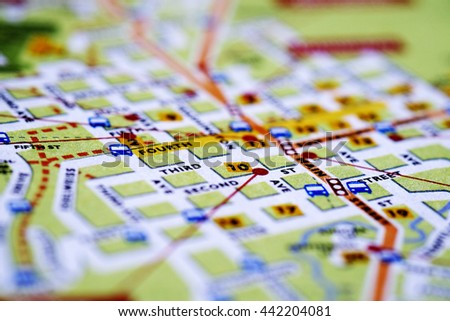 Closeup map of city with streets for travel destination driving - stock photo