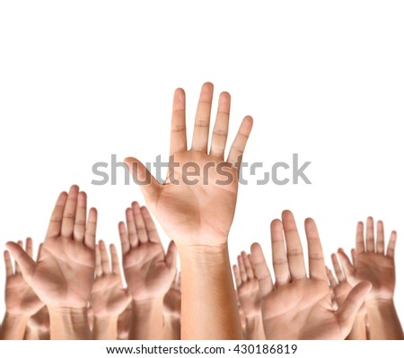 Closeup men and women raising hands against  - stock photo
