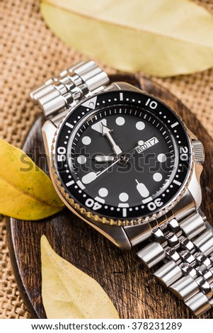 closeup men dive watch with stainless steel bracelet - stock photo