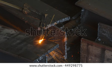 Closeup metal cutter, steel cutting with acetylene torch, industrial worker on manufacturing area. - stock photo