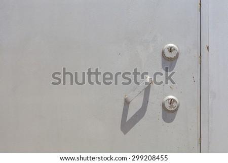 Closeup metal door with lock. - stock photo