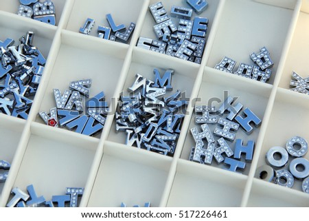 closeup metal letters of the Russian alphabet-magnets in a box