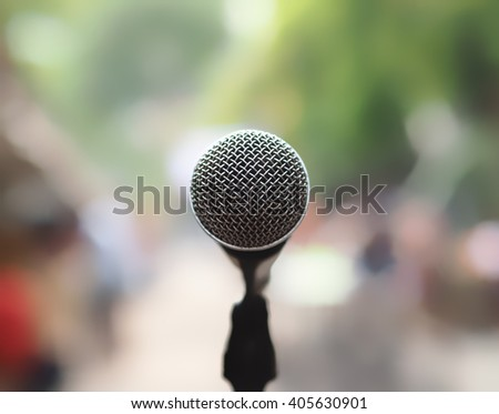 closeup microphone in blurred background with effect film bright light filter, single microphone in the park and blurred background