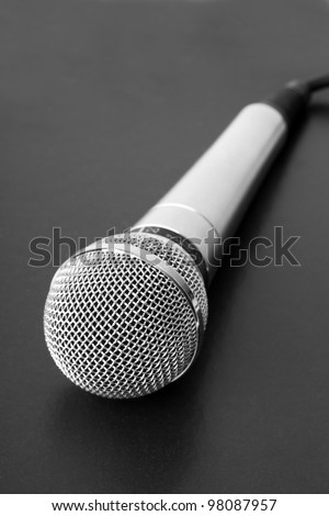 Closeup microphone on black background