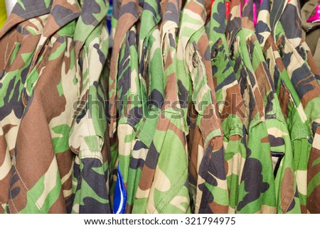 closeup military shirt on hanger in shop - stock photo
