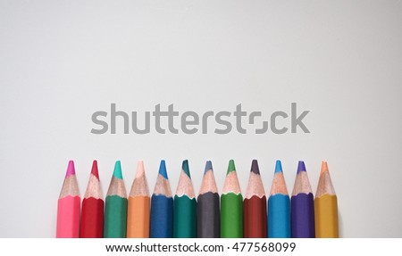 Closeup mix Colour pencils isolated on white background.