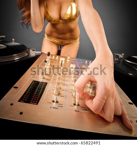 closeup mixer - Beautiful DJ girl on decks on the party with plain background - stock photo
