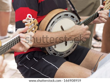 Closeup - Musical instruments String - Banjo and guitar - chorinho music - musicians playing in the public square of the city of Rio de Janeiro - stock photo