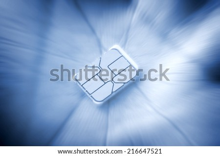 closeup nano SIM card on human hand - stock photo