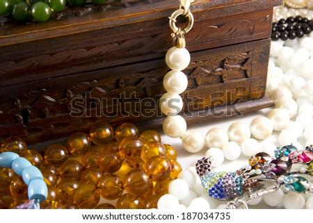 Closeup, necklaces with colored stones, jewelry, bijouteria - stock photo